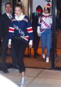 Gigi and Bella Hadid sport matching New York Rangers jerseys on their way to a hockey game at Madison Square Garden in New York City