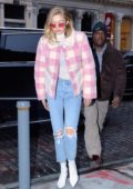 Gigi Hadid steps out wearing a pink and white checkered jacket in Manhattan, New York City