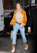Gigi Hadid wearing a yellow fur jacket with cropped blue jeans while out for the day in New York City