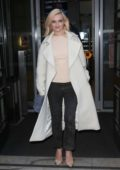 Grace Chatto leaving BBC Radio 2 wearing a white coat in London