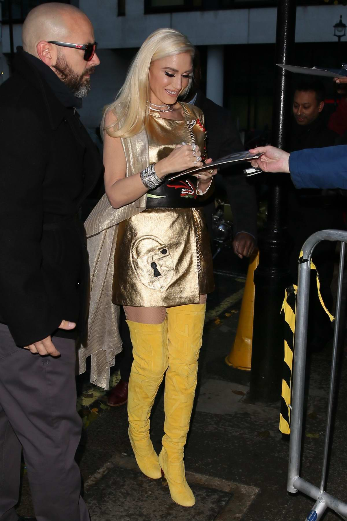 Gwen Stefani in a golden dress and high yellow boots arriving at BBC Radio 2 in London