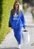 Heidi Klum wears a bright blue Adidas sweatsuit while shopping for Christmas in West Hollywood, Los Angeles