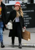 Hilary Duff and boyfriend Matthew Koma hold hands as they shop around Soho in New York City