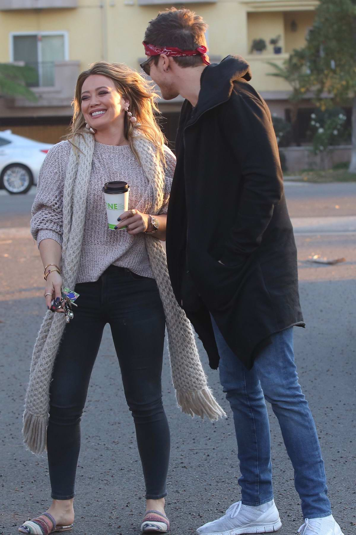 Hilary duff and boyfriend Matthew Koma share a kiss while out for coffee in Studio City, Los Angeles