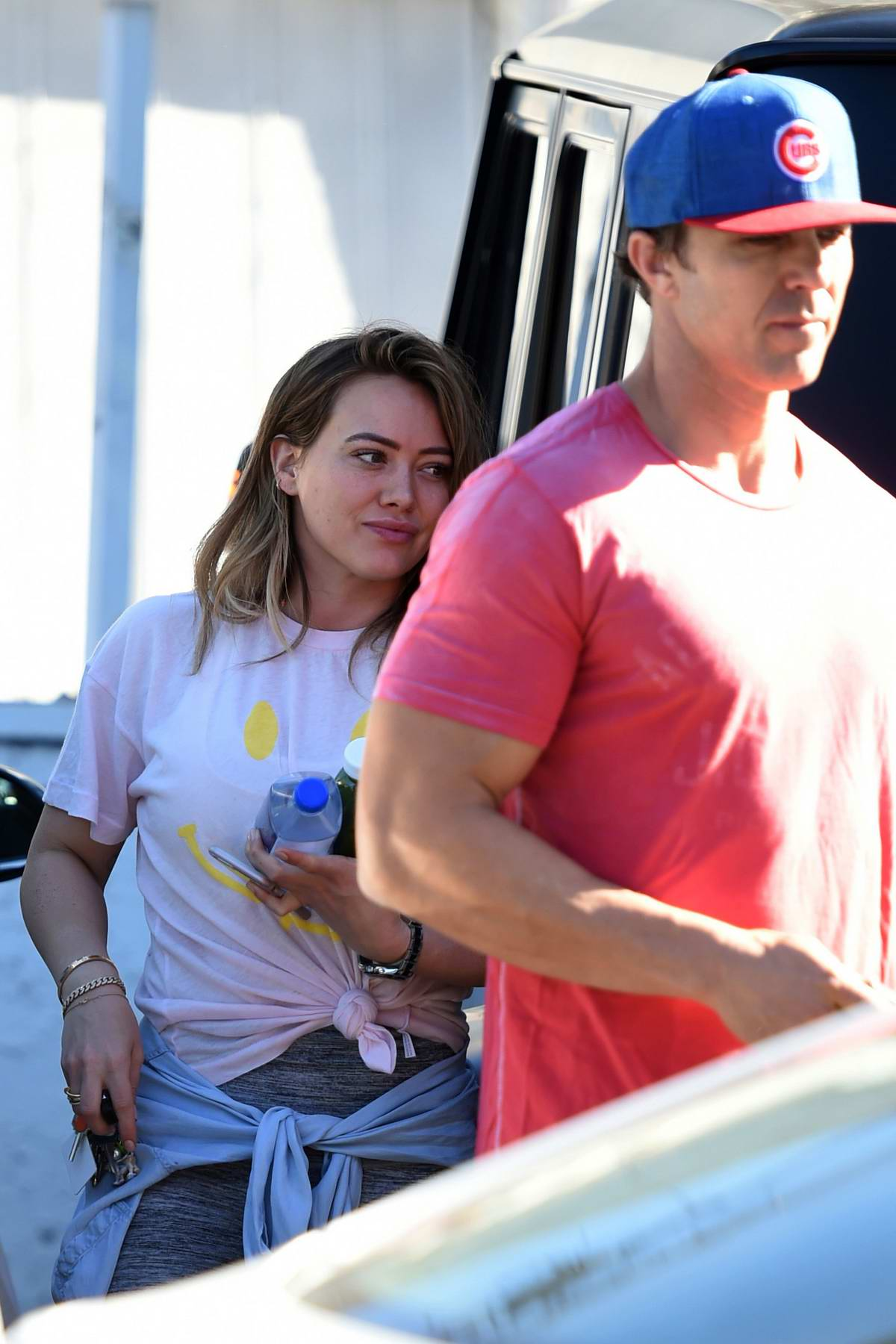 Hilary Duff gets escorted into the gym by her trainer in Los Angeles