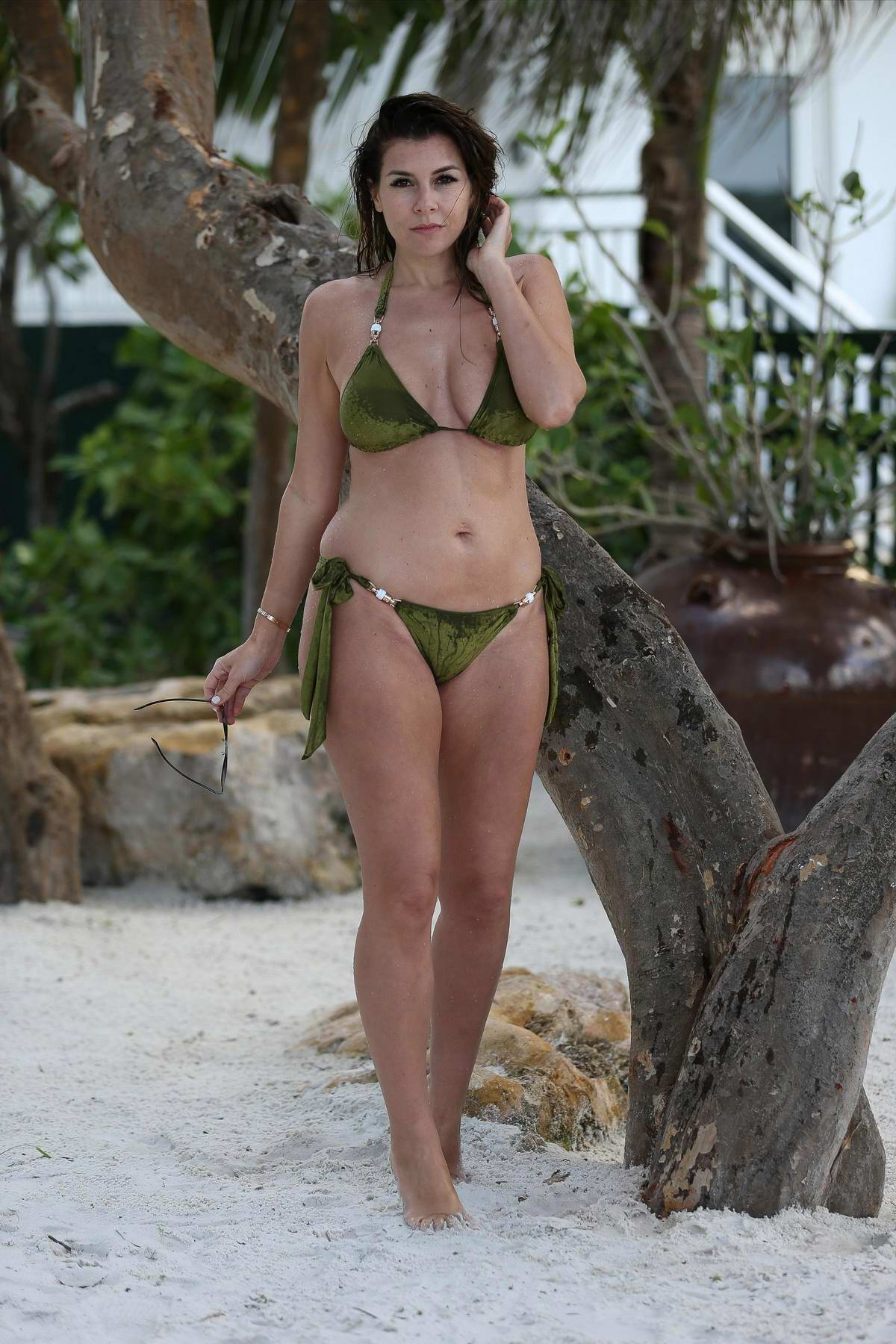 Imogen Thomas wears a green bikini during her stay in Miami, Florida