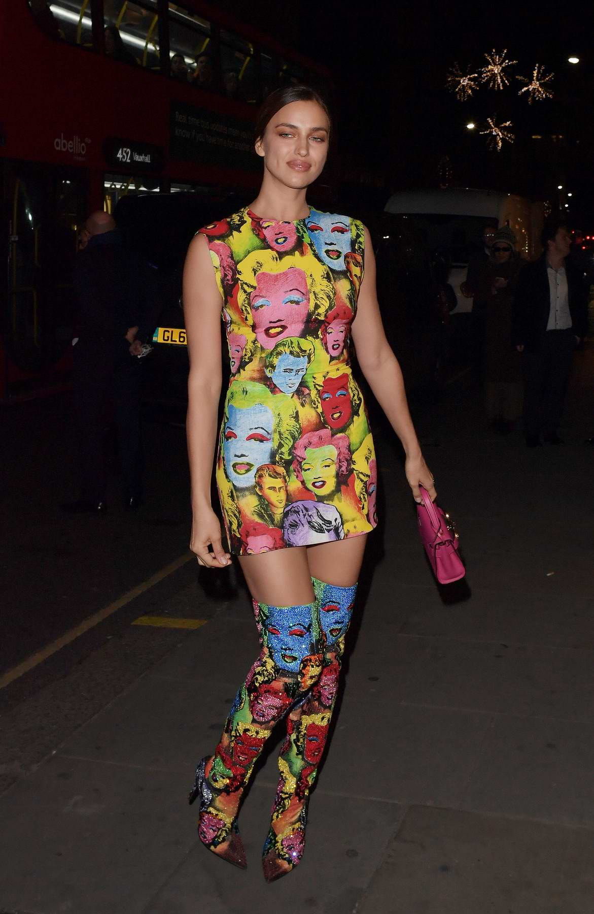 Irina Shayk rocks a colorful mini dress attends Versace Sloane Street launch in London