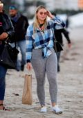 Iskra Lawrence enjoys a walk with friends on the beach in Miami, Los Angeles