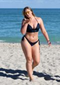 Iskra Lawrence in a navy blue bikini enjoying a day on the beach with friends in Miami, Florida