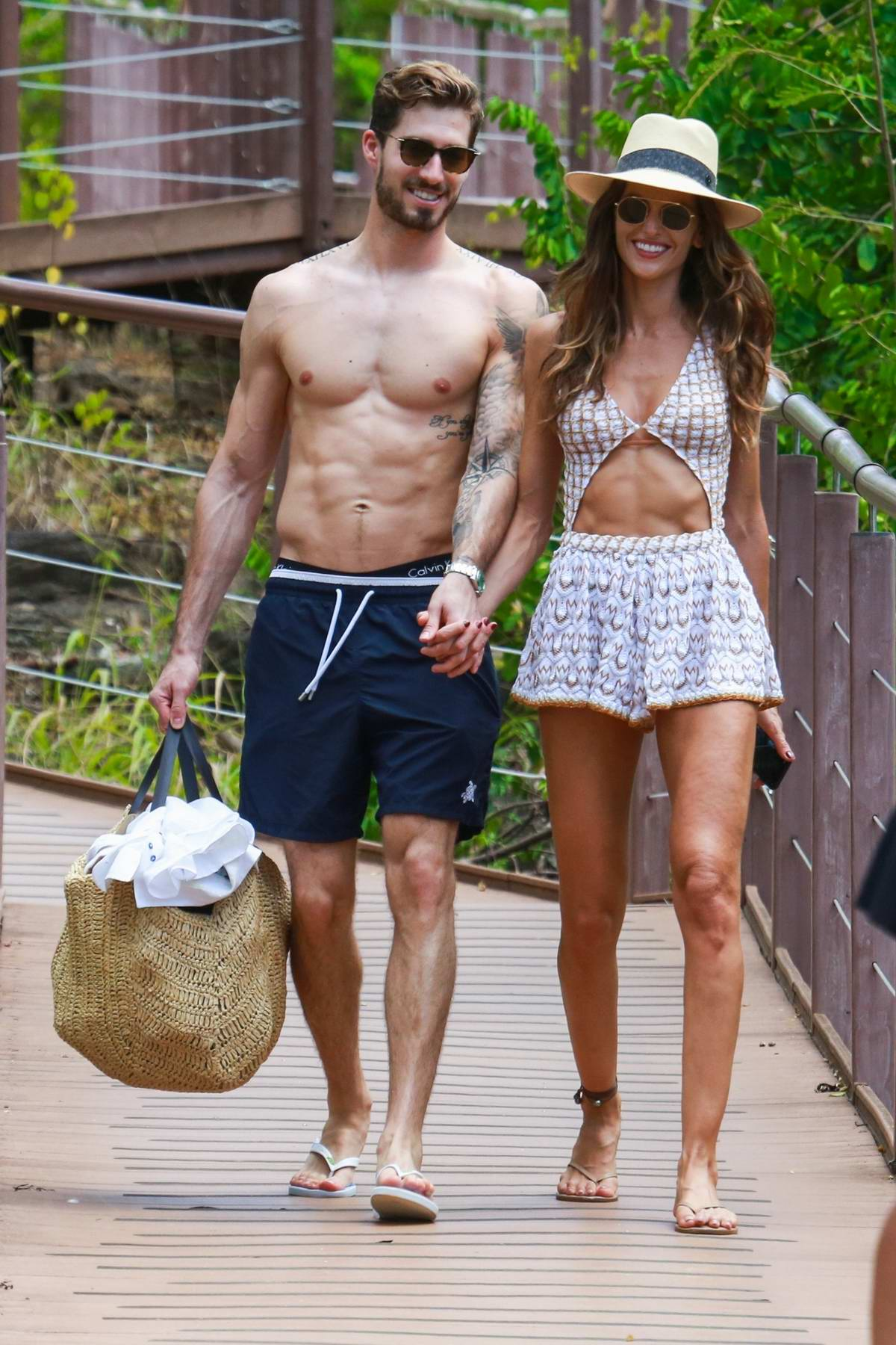 Izabel Goulart and Kevin Trapp head to the beach in Fernando de Noronha, Brazil
