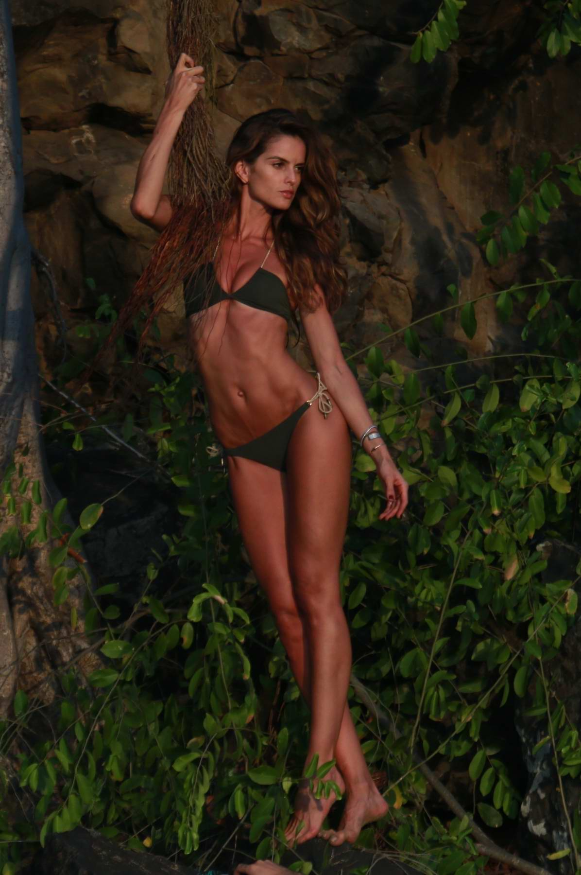 Izabel Goulart poses for a photoshoot in a green bikini at Fernando de Noronha, Brazil