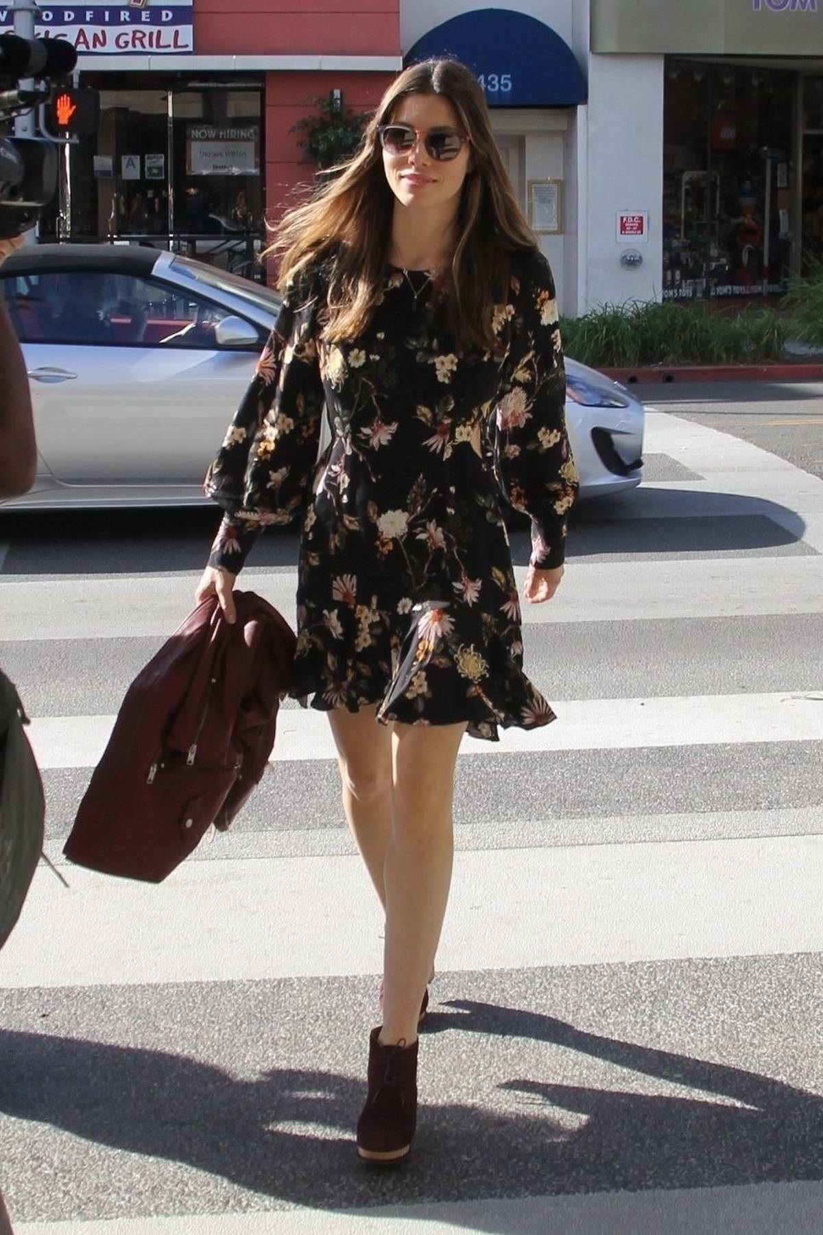 Jessica Biel steps out in a cute floral dress with a red biker jacket in Beverly Hills, Los Angeles