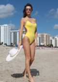 Julia Pereira in a yellow swimsuit on the beach in Miami, Florida