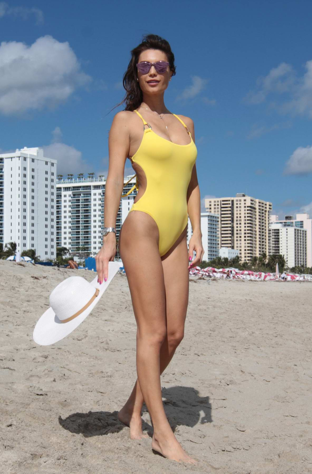Julia Pereira in a yellow swimsuit on the beach in Miami, Florida