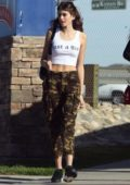 Kaia Gerber in a vest top and camo pants leaving an IHOP after having lunch with friends in Los Angeles