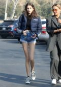 Kaia Gerber wears denim short and Fila jacket to a breakfast with friends in Malibu, California