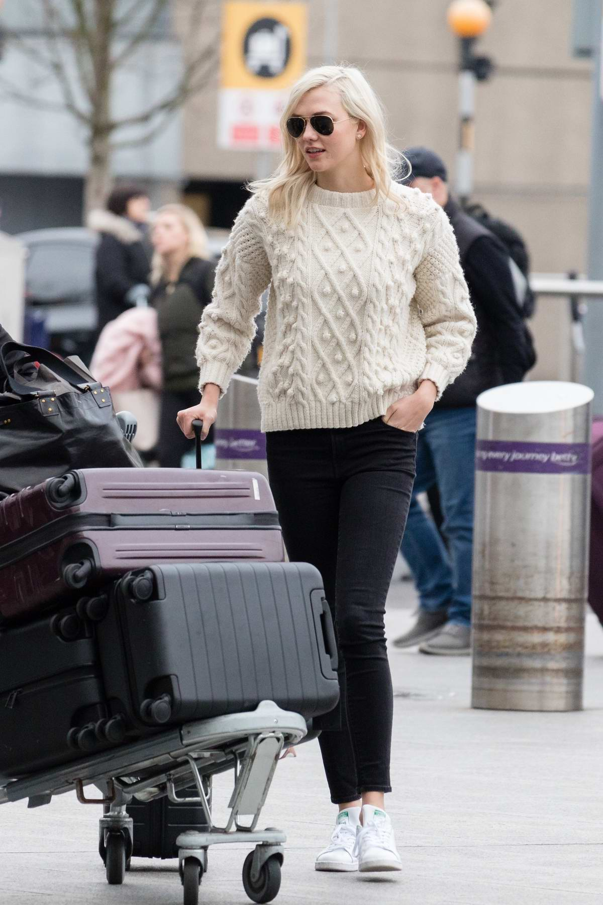 Karlie Kloss spotted at Heathrow airport as she flies out of London