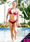 Katharine McPhee in a magenta bikini enjoying her vacation by the pool in Mexico