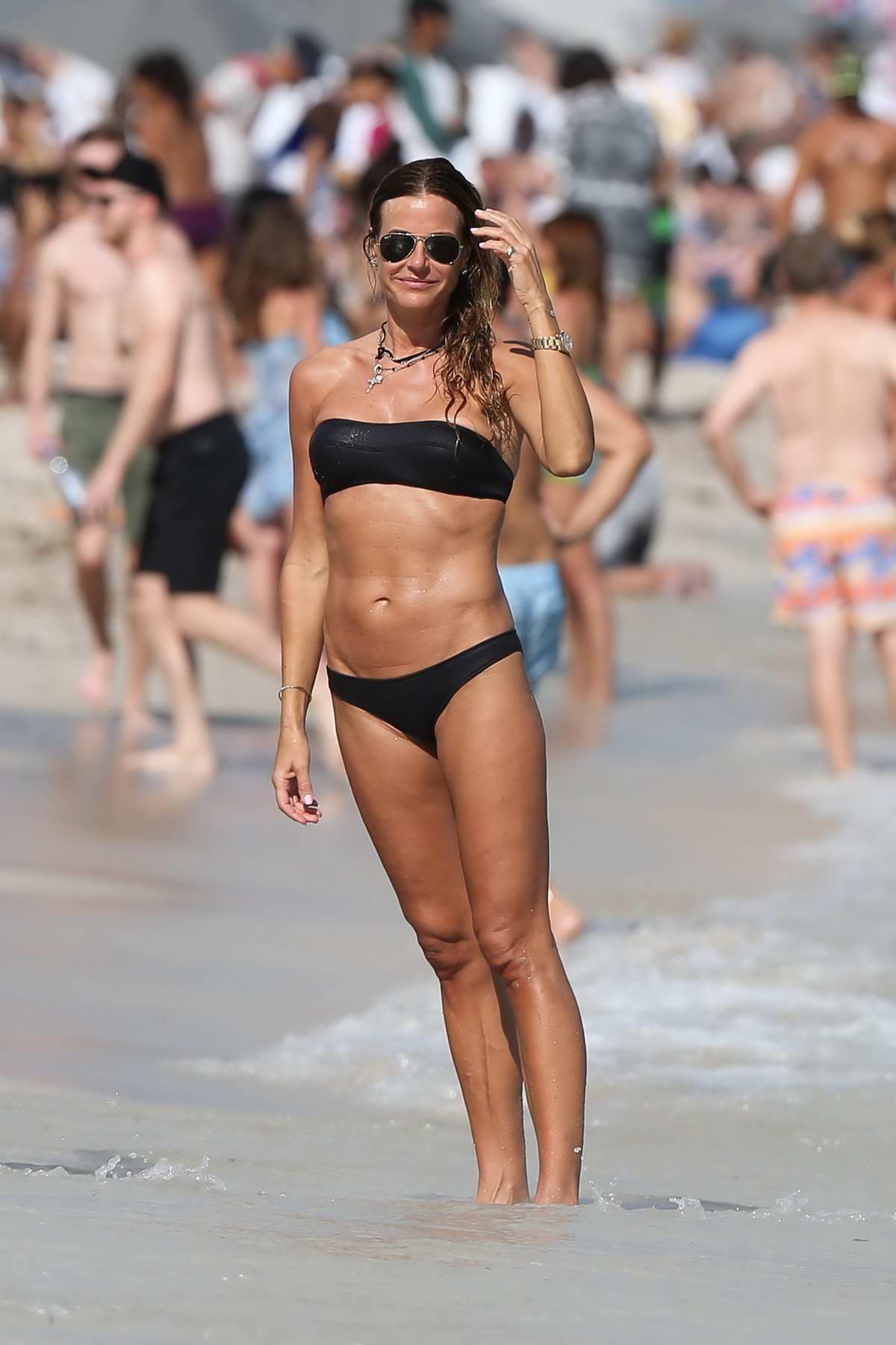 Kelly Bensimon hits the beach in a black bikini in Miami, Florida
