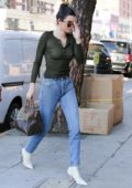 Kendall Jenner in a olive top and jeans exiting Rage Ground in Los Angeles