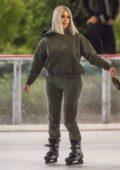 Kim Kardashian enjoys some ice skating at a Christmas party in Thousand Oaks, California