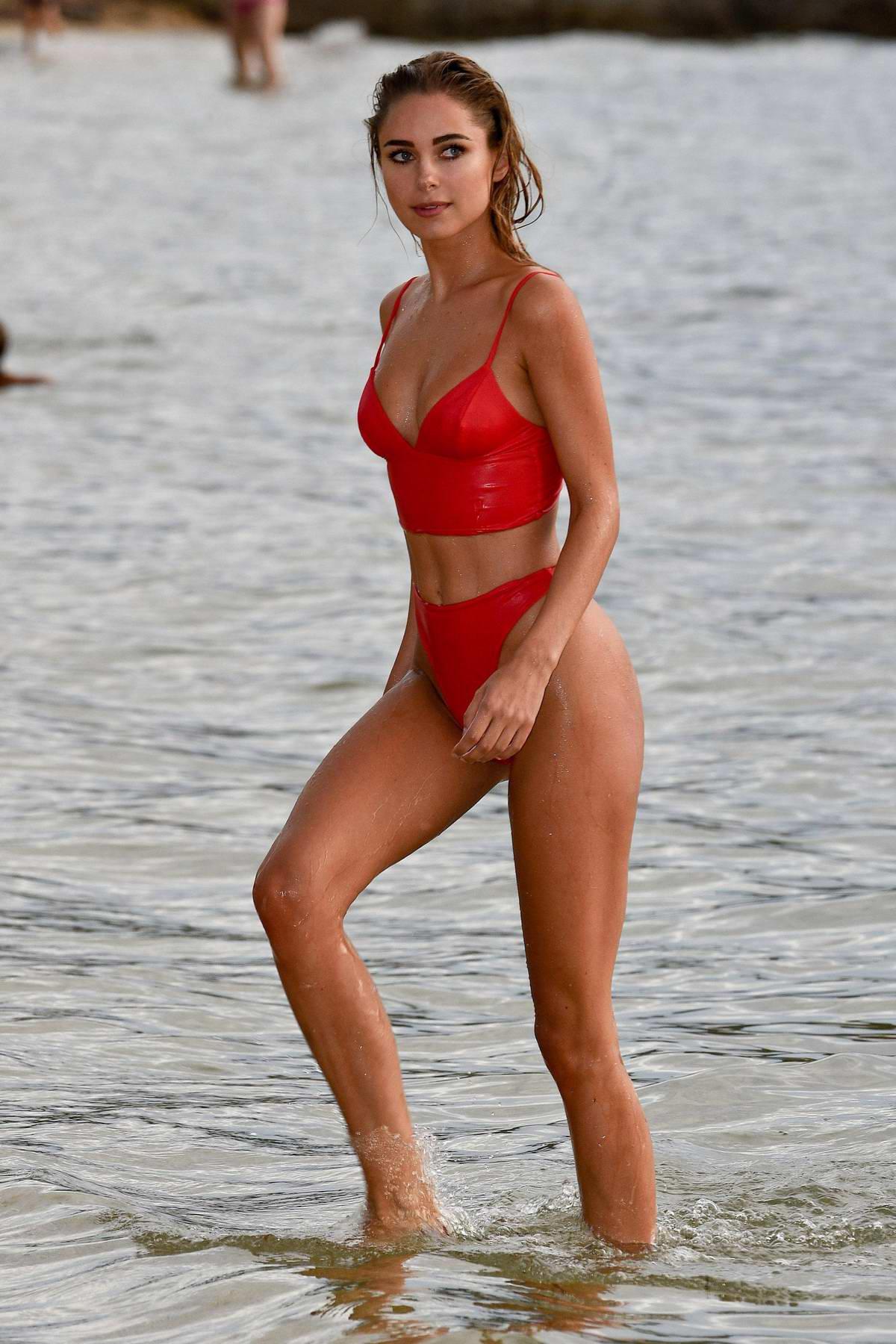 Kimberley Garner in a red bikini enjoys some paddle-boarding in Caribbean