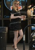 Kirsten Dunst in a short summer dress stops for an iced coffee at Alfred Coffee in Studio City, Los Angeles