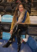 La La Anthony sits court side at Madison Square Garden in New York City