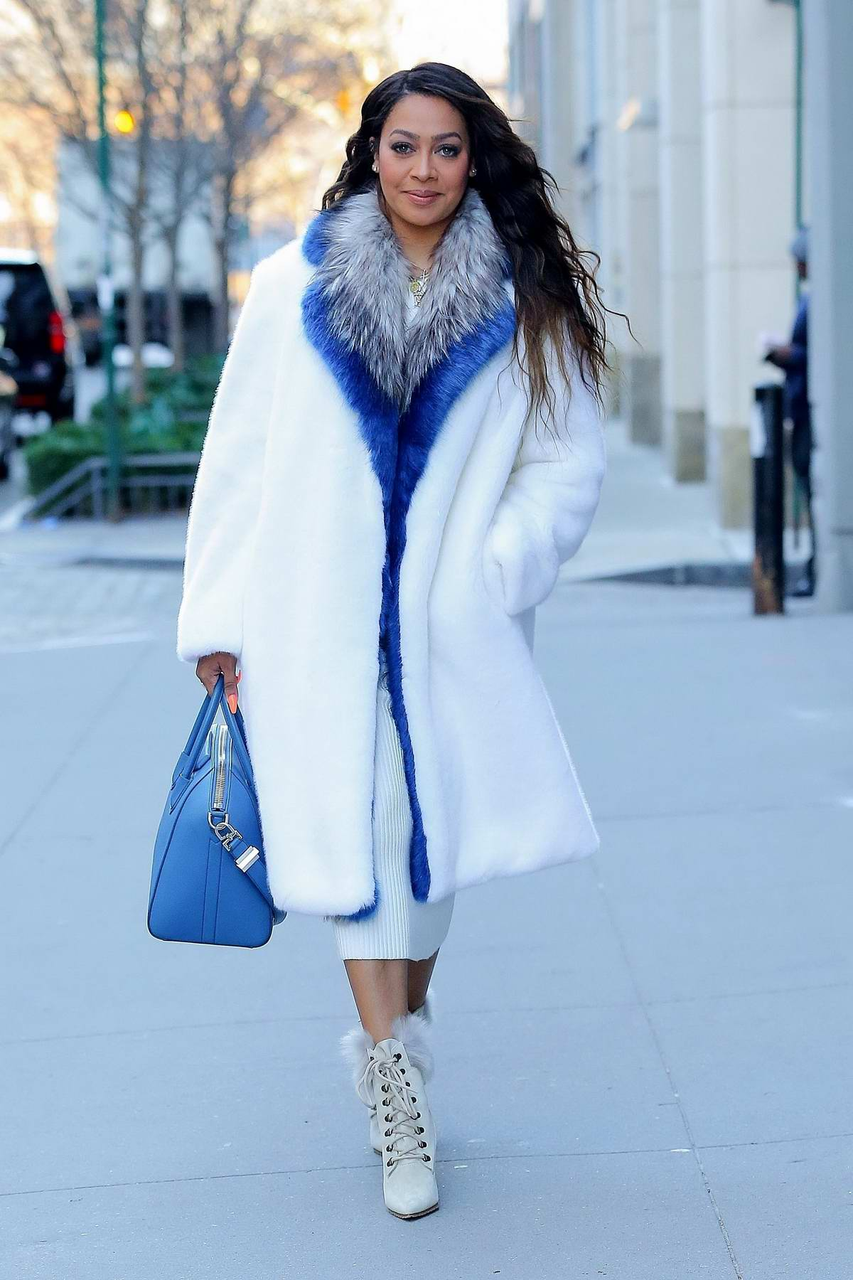 La La Anthony steps out in a white and blue winter inspired look in New York City