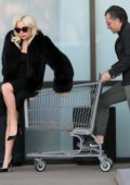 Lady Gaga does her groceries in true fashion diva as she gets a shopping cart ride from fiance Christian Carino in Malibu, California