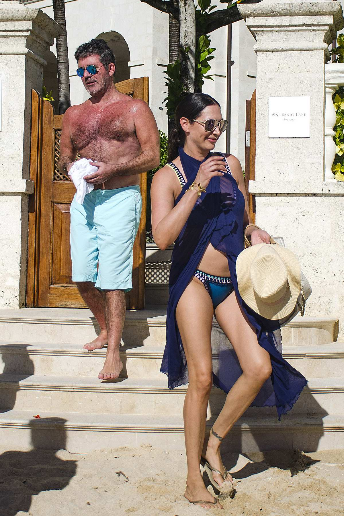 Lauren Silverman in a blue bikini at the beach with her family in Barbados