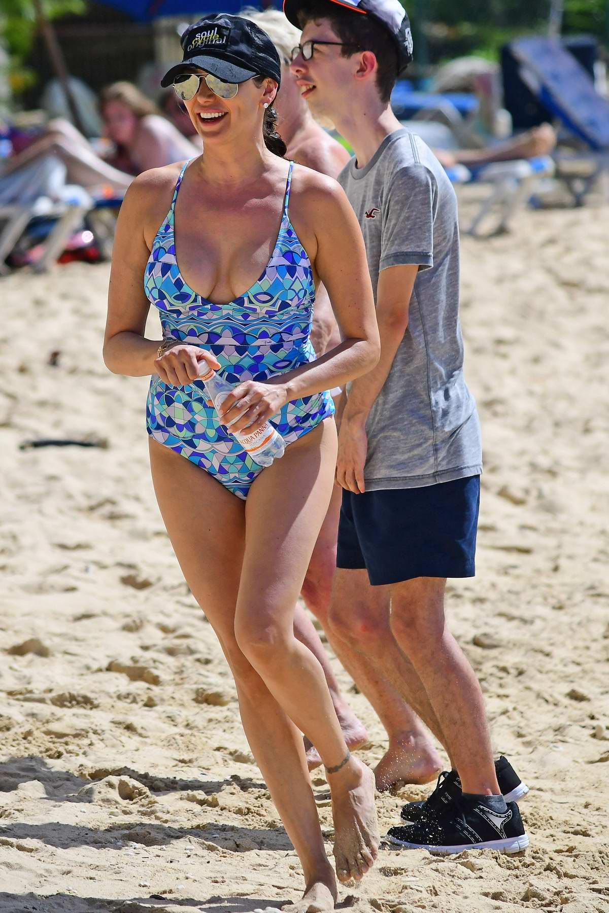 Lauren Silverman in a blue patterned swimsuit spends another day with her family at the beach in Barbados