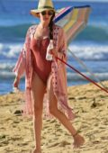 Lauren Silverman take the dogs for a walk wearing a swimsuit on the beach in Barbados