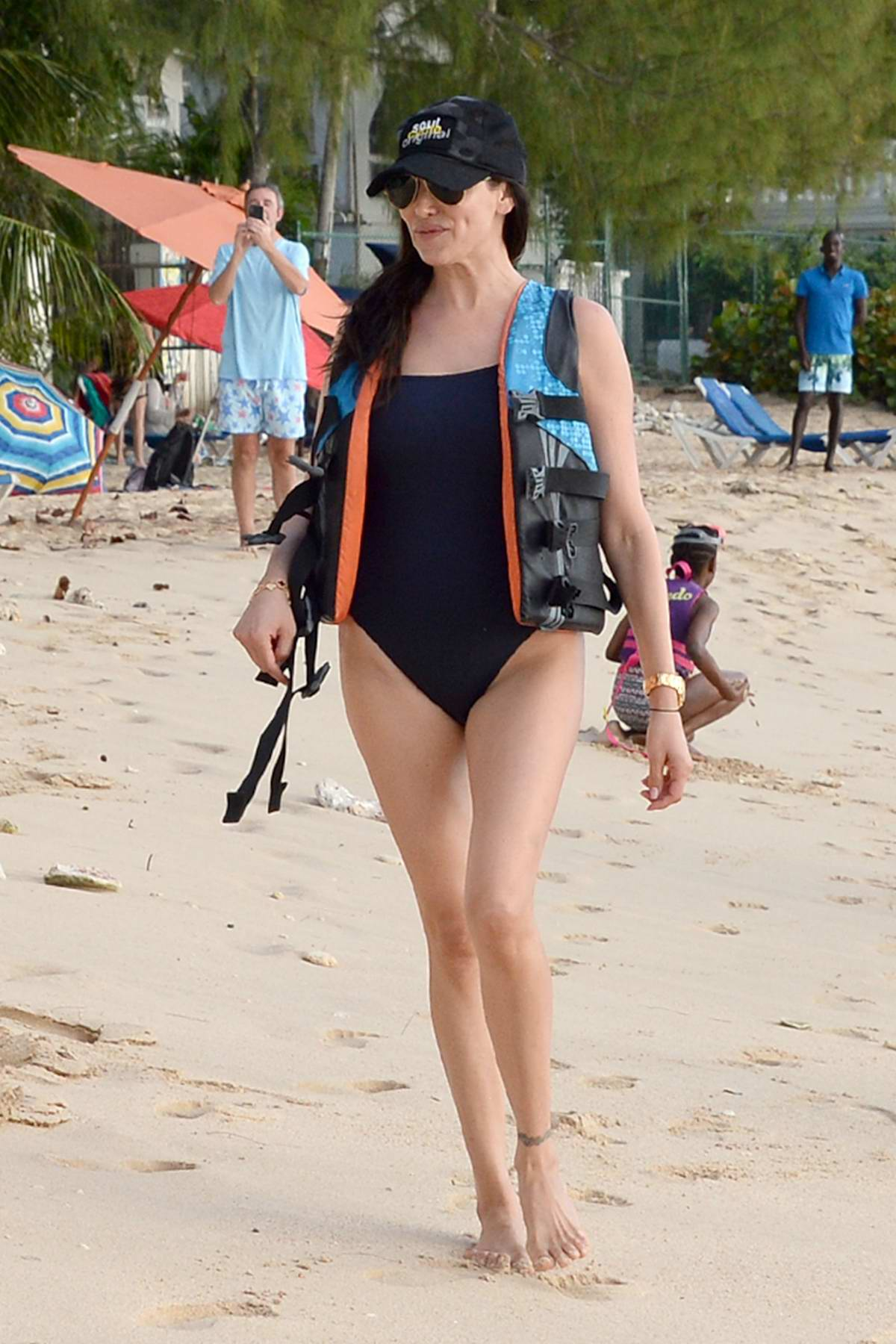 Lauren Silverman wearing a blue swimsuit while she rides a jet ski in Barbados