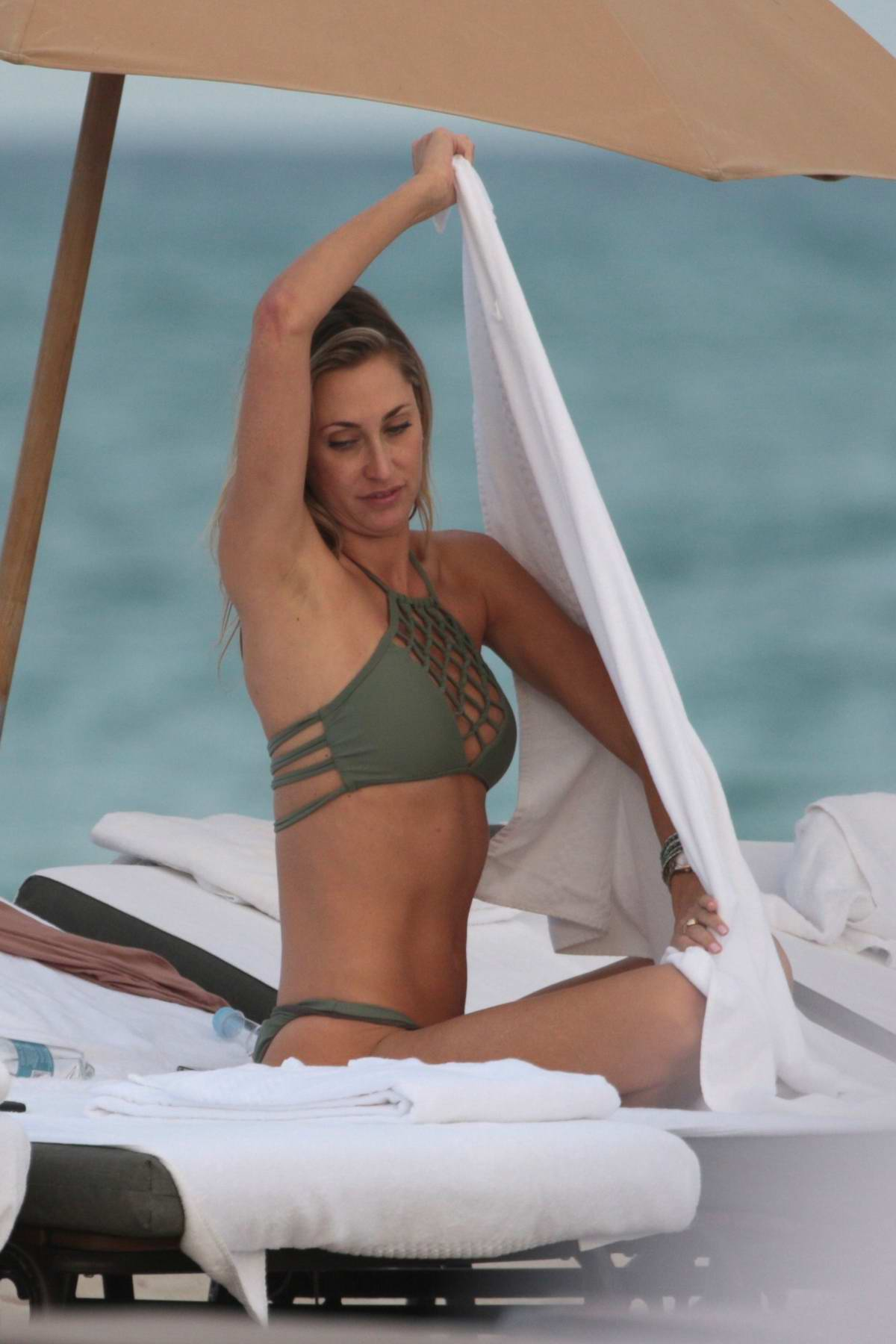Lauren Stoner in an olive green bikini at the beach in Miami, Florida