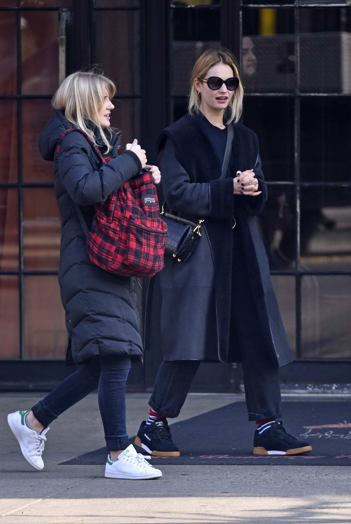 Lily James spotted with a friend in the East Village, New York City