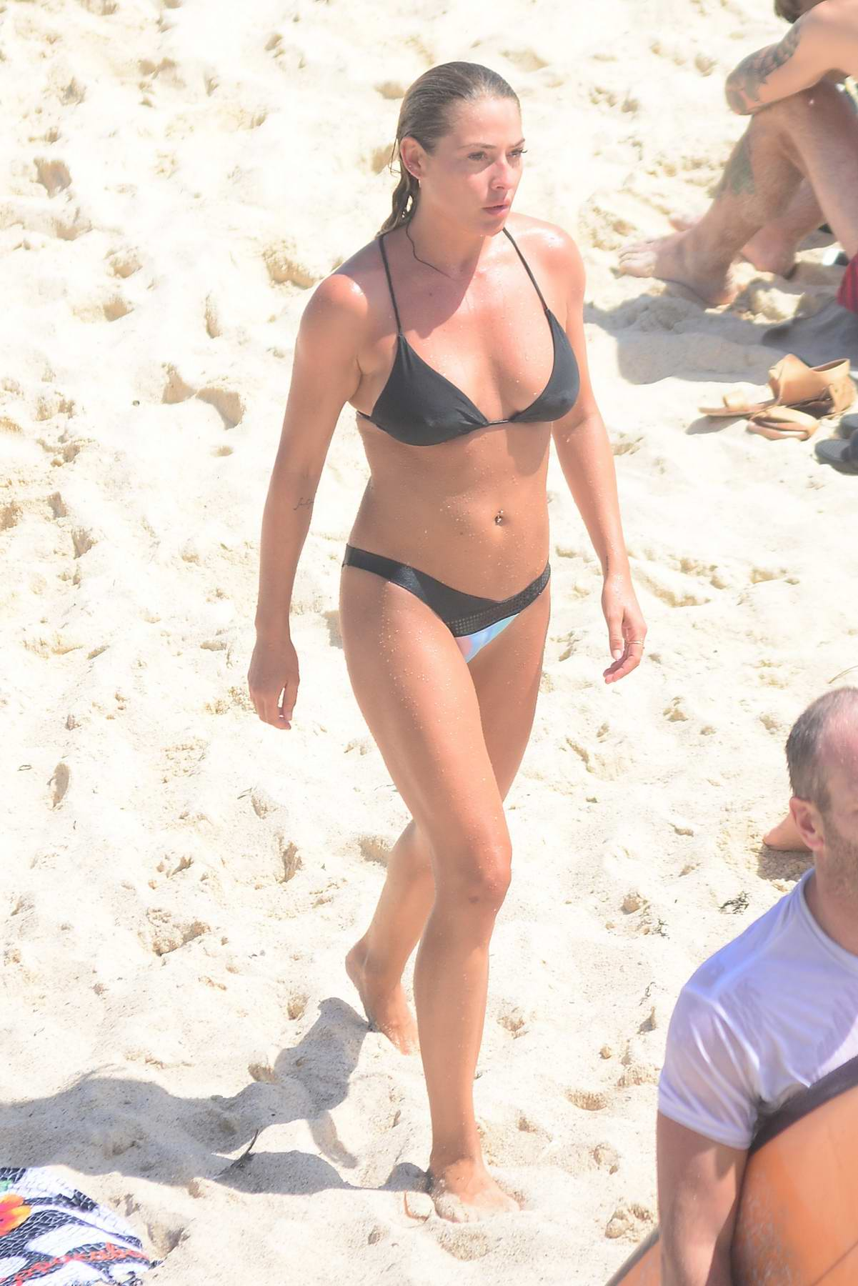 Lisa Clark dons a bikini as she goes for a dip at Tamarama beach, Bondi, Australia