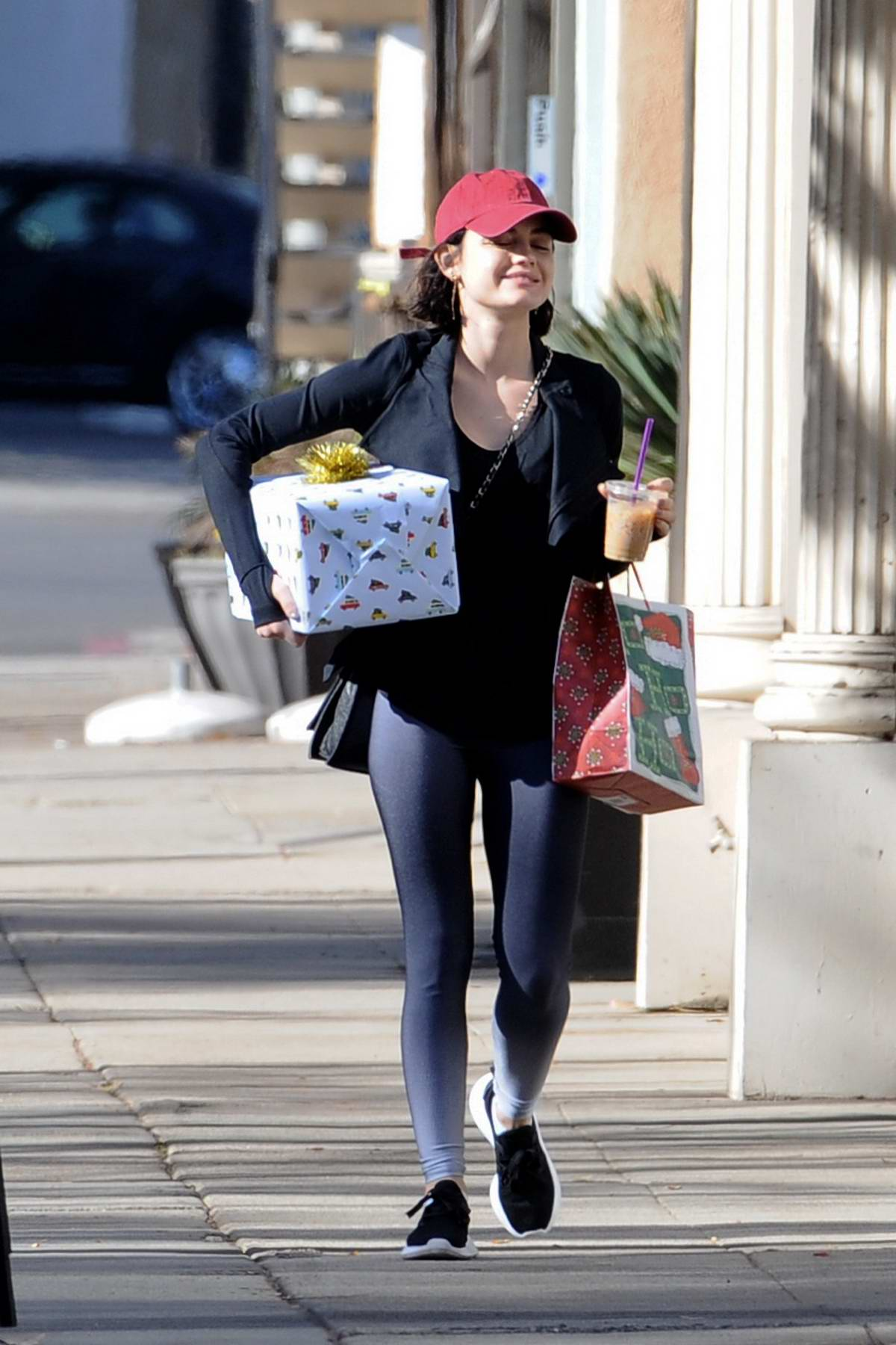 Lucy Hale exchanging Christmas gifts with friends outside of Granville restaurant in Studio City, Los Angeles