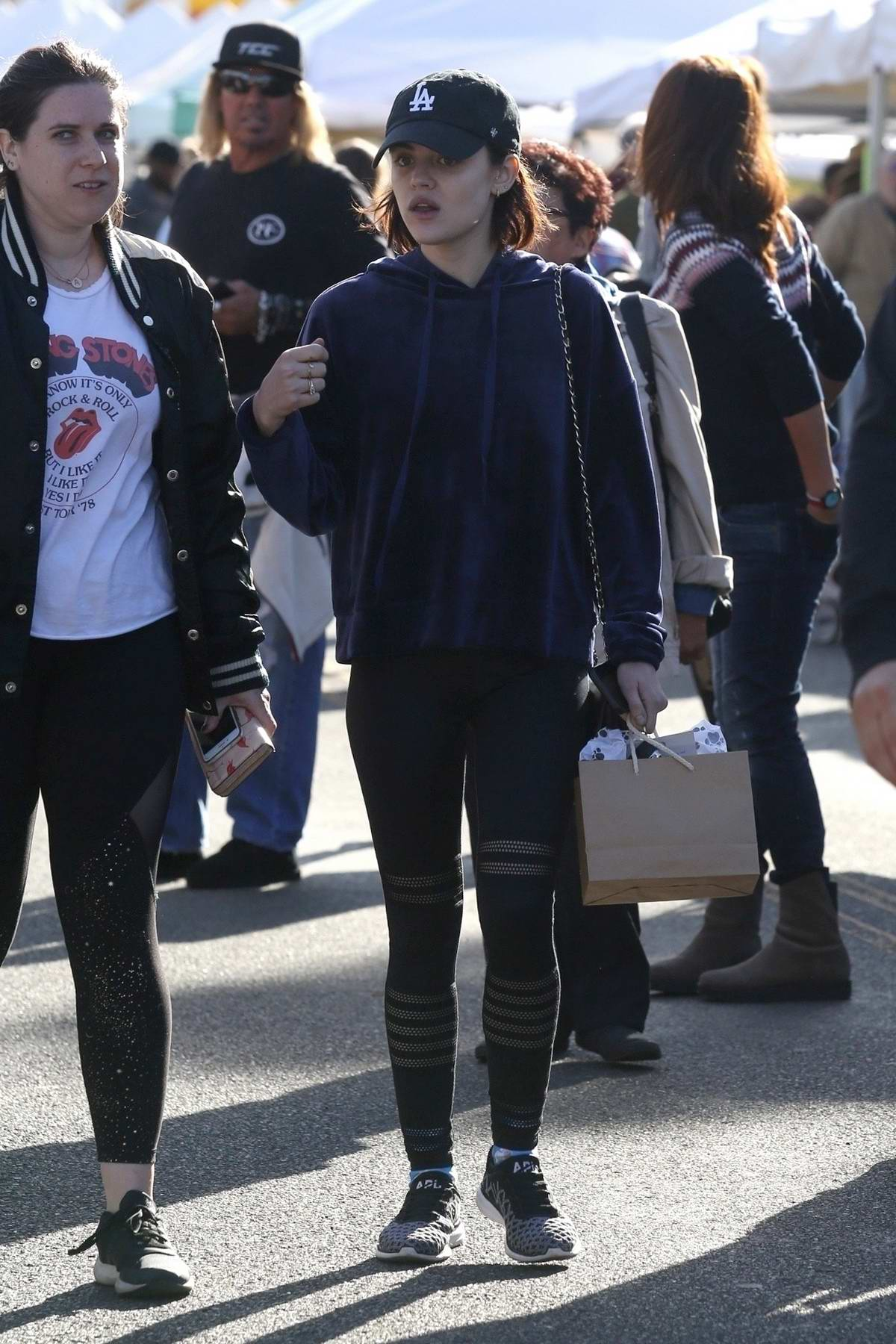 Lucy Hale sports a blue velvet hoodie while shopping at the farmer's market in Studio City, Los Angeles