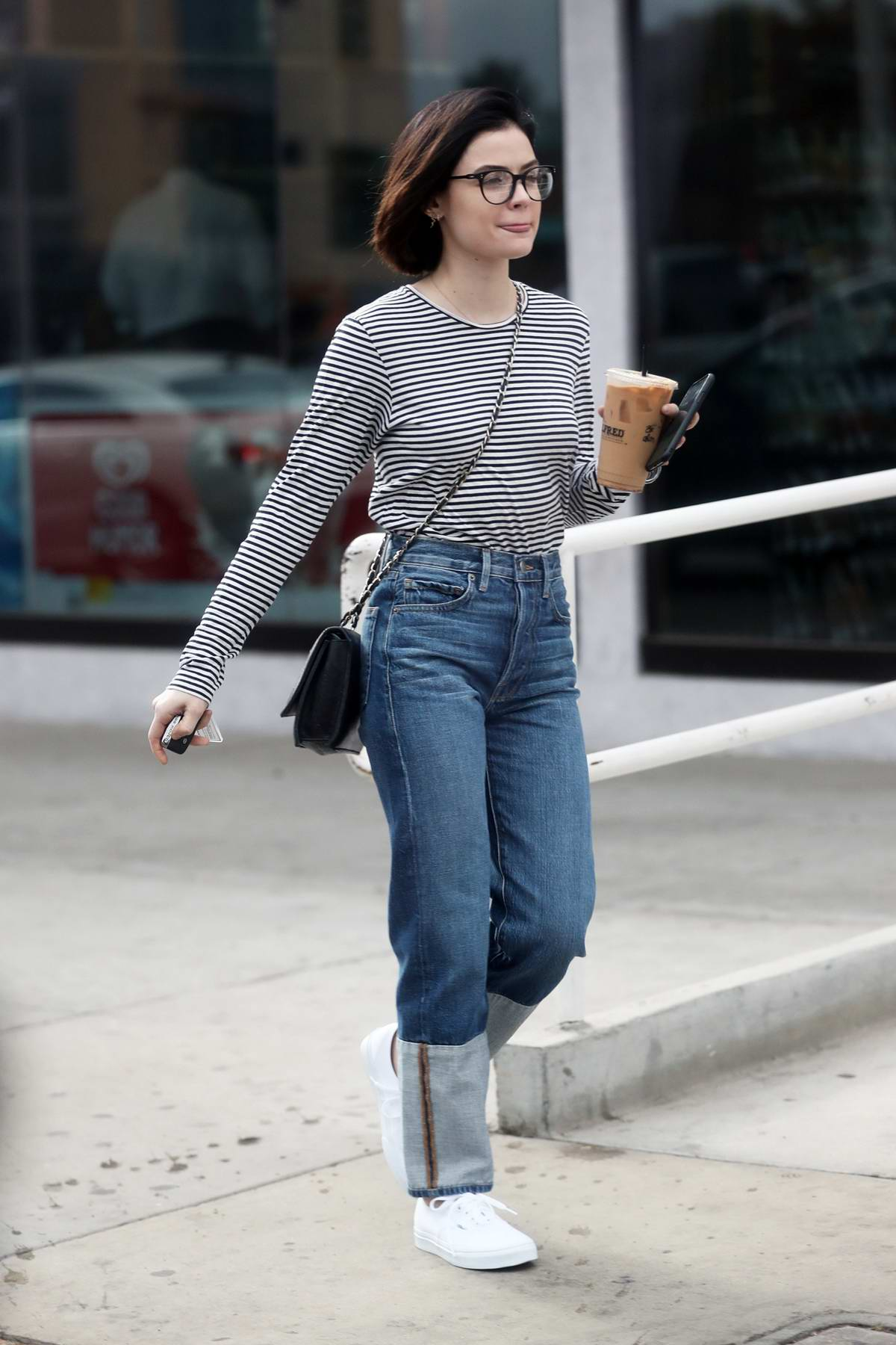 Lucy Hale wears stripes while out grabbing an iced coffee in West Hollywood, Los Angeles