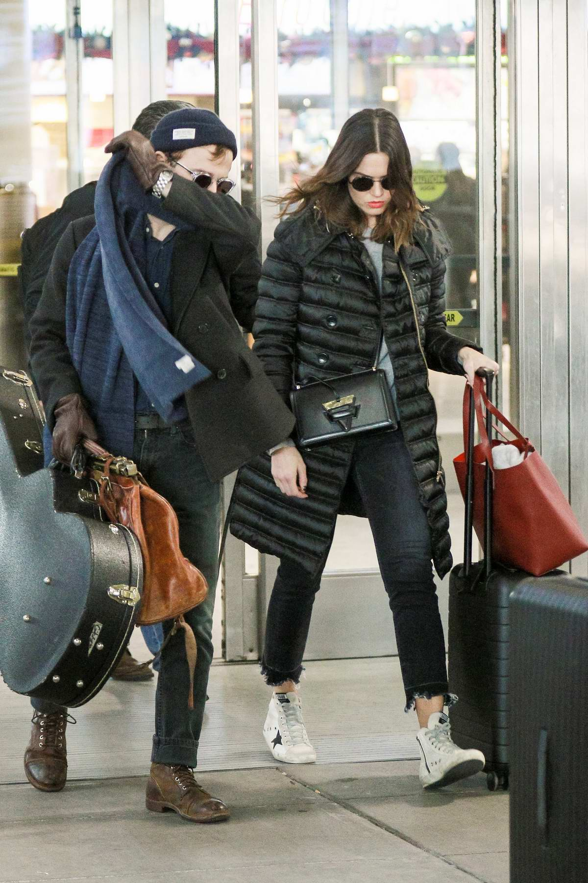 Mandy Moore and her ex husband Ryan Adams arrives at JFK airport in New York City