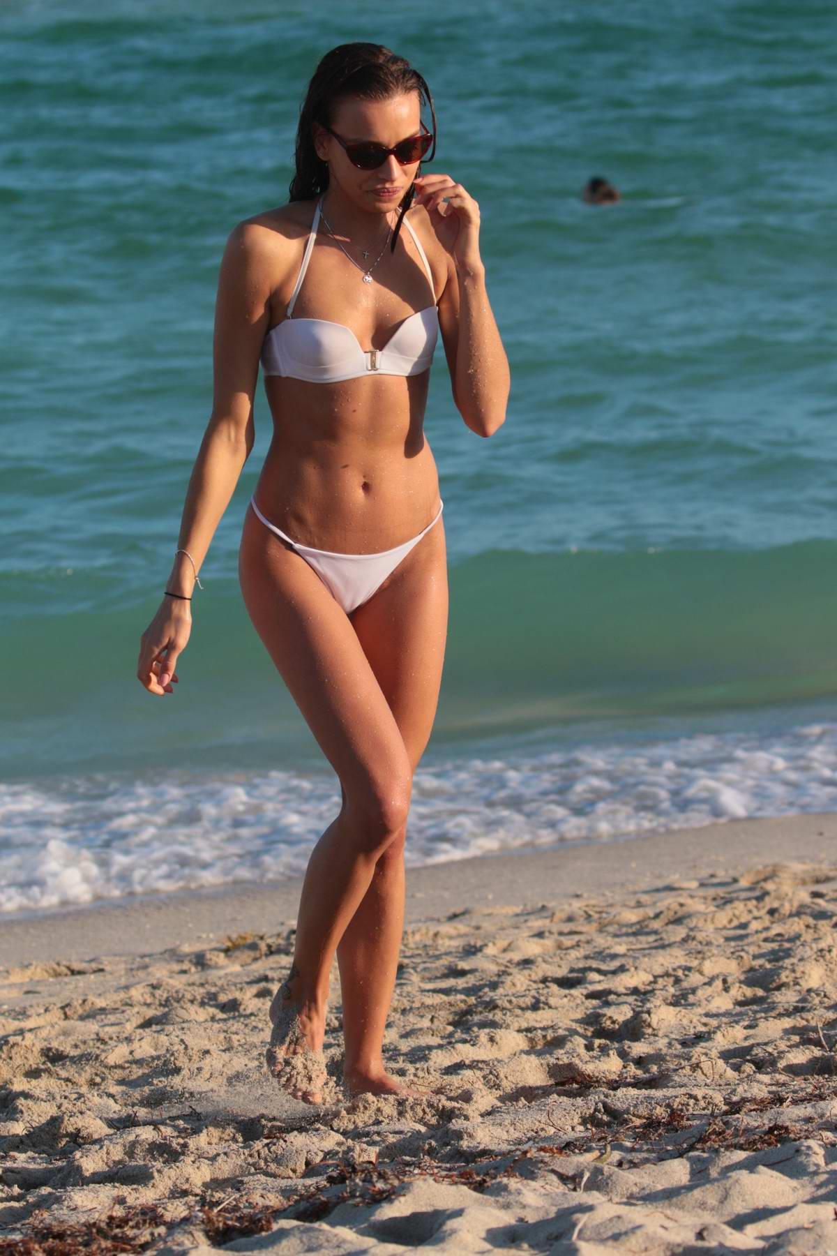 Meri Gulin in a white bikini at the beach in Miami, Florida
