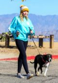 Miley Cyrus sports a knit cap with pom pom while out on a hike with her dog in Los Angeles