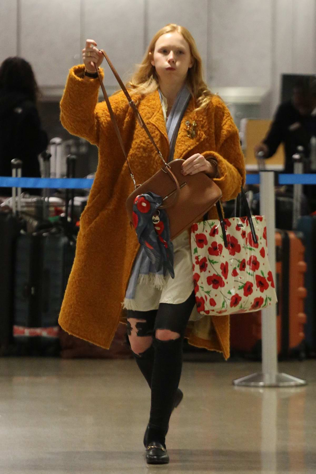 Molly Quinn in an orange coat arrives at LAX airport in Los Angeles