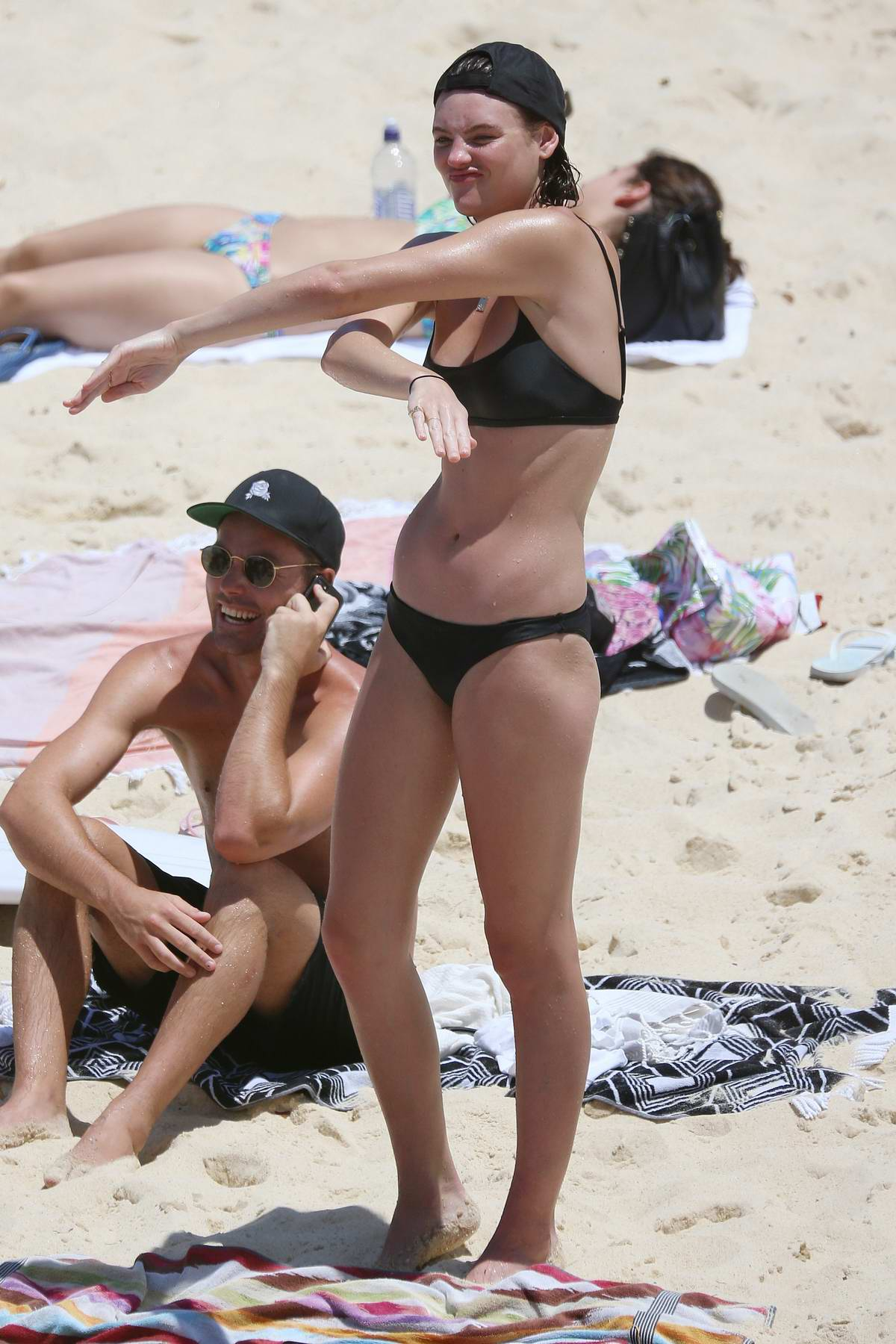 Montana Cox wears a bikini while sunbathing with friends at Tamarama beach in Sydney, Australia