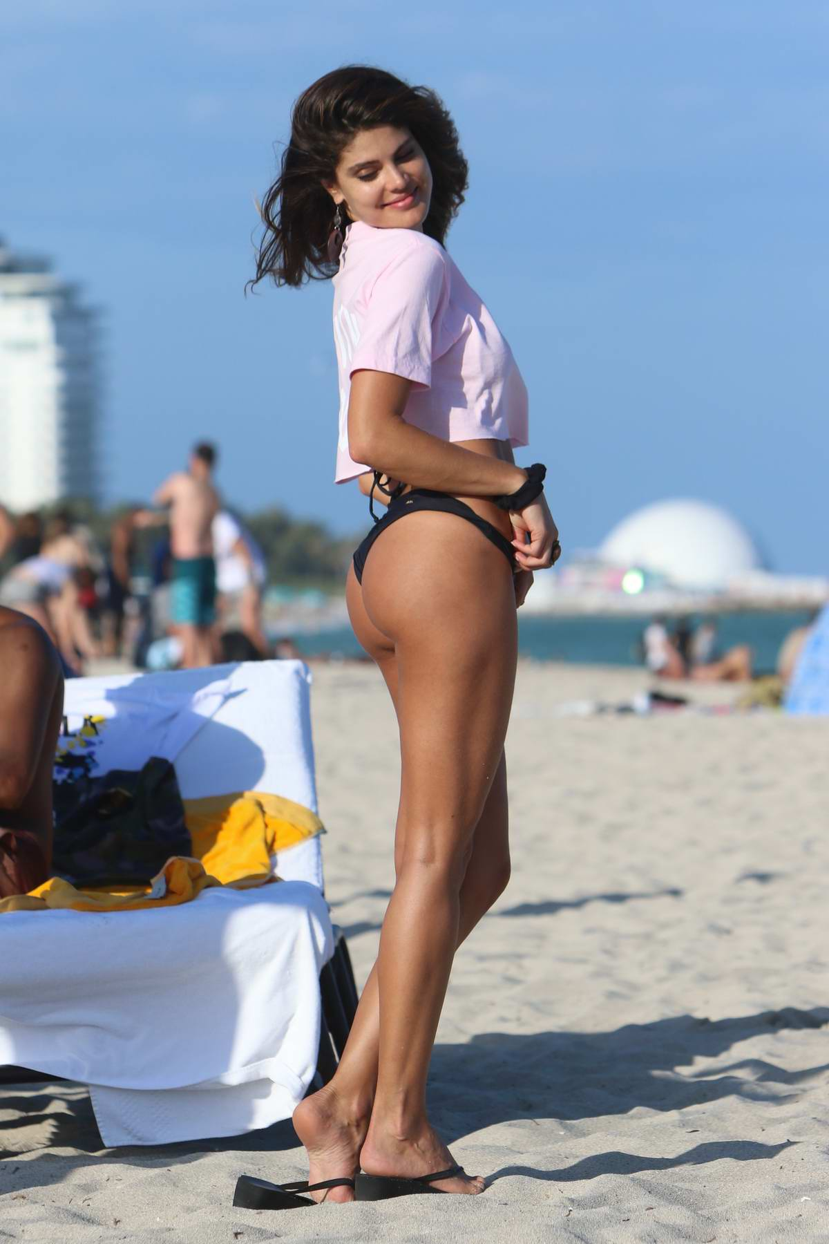 Natalya Alberto in a black bikini spotted at the beach in Miami, Florida