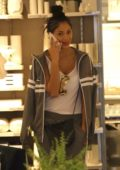 Nicole Scherzinger chats on the phone while shopping for home goods at CB2 in West Hollywood, Los Angeles