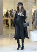Nicole Trunfio in all black ensemble shows off her baby bump while shopping with her husband Gary Clark Jr. in Los Angeles