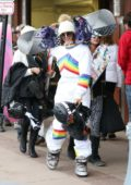 Nina Dobrev heads for another day of skiing wearing a rainbow striped white ski suit in Aspen, Colorado