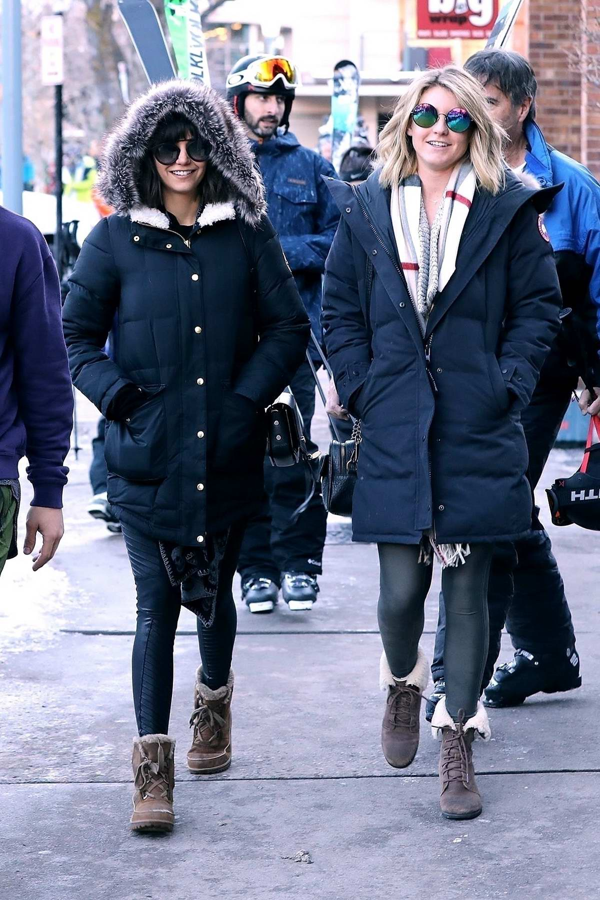 Nina Dobrev wearing a fur lined parka while out with her friends in Aspen, Colorado